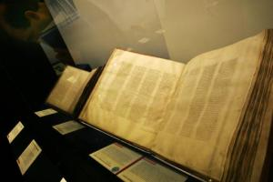 A Codex Sinaiticus manuscript, right, the earliest complete New Testament, from 4th century Egypt or Palestine on display in the 'Sacred : Discover what we share' exhibition at the British Library in London, Wednesday, April 25, 2007. The exhibition brought together important religious texts from the Jewish, Christian and Muslim faiths. (AP Photo/Sang Tan)
